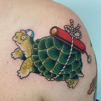 Cute tattoo by Wendy Pham #WendyPham #cutetattoos #cute #sweet #tattoosforgirls #tattoosforwomen #tattooideas #cooltattoos #love #color #shoulder #turtle #dynamite #funny