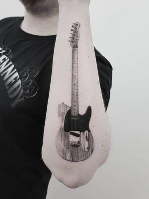 Guitar tattoo by Max Thommesen Ink #MaxThommesen #ThommesenInk #tattoodo #tattoodoapp #tattoodoappartists #besttattoos #awesometattoos #tattoosforwomen #tattoosformen #cooltattoos #tattooideas #blackandgrey #guitar #realism #arm