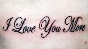 """I Love You More"" Tattoo (Ribs) #DocDidIt #Cursive #CursiveTattoo #LoveTattoo"