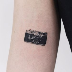 Cool tattoo by Saegeem #Saegeem #cooltattoos #tattooidea #cooltattoo #cool #favorite #bestoftheday #tattoosforwomen #tattoosformen #camera #analog #35mm #arm #realism #realistic