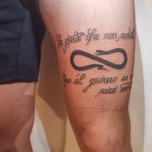 Lettering tattoo.