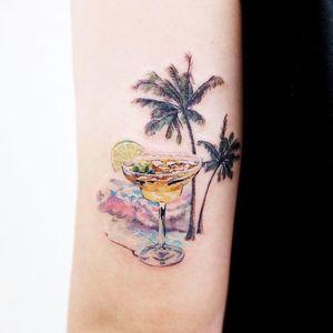 Cool tattoo by Guseull Tattoo #GuseulTattoo #cooltattoos #tattooidea #cooltattoo #cool #favorite #bestoftheday #tattoosforwomen #tattoosformen #cocktail #beach #palmtrees #waves #arm #illustrative #watercolor