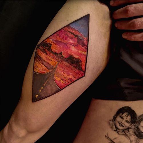 Long road tattoo by Jones Larsen #JonesLarsen #LacunaTattoo #realism #realistic ##mashup #tattoodoapp #tattooartist #tattooidea #cooltattoo #copenhagen #denmark #road #landscape #sunset #desert #leg #color