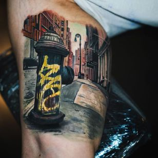 City street scene tattoo by Yomico #Yomico #realismtattoo #realismtattoos #realism #realistic #hyperrealism #tattooideas #city #street #urban #graffiti #buildings #architectiure #newyork #arm #color