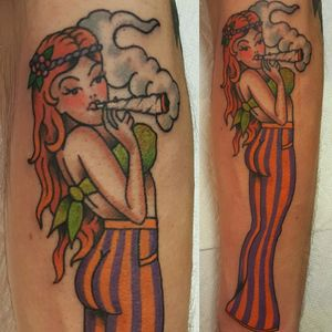 Traditional American pinup girl redhead hippie striped pants smoking joint weed Marijuana
