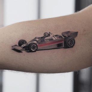 Ferrari tattoo by Jefree Naderali #jefreenaderali #realismtattoo #realismtattoos #realism #realistic #hyperrealism #tattooideas #ferrari #car #racing #racecar #blackandgrey #arm