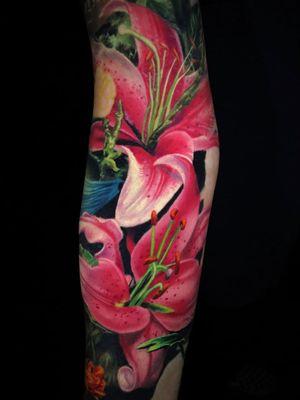 Flower tattoo by Jamie Schene #JamieSchene #TattoodoApp #TattoodoApptattooartist #tattooartist #tattooart #tattooidea #inspiringtattoo #besttattoo #awesometattoo #tigerlily #flower #floral #sleeve #arm #color