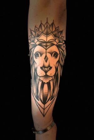 Geometric Mandala Lion Tattoo on the Forearm