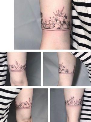 #wraparound tattoo by Miko #flowers #thinlines #blacklines