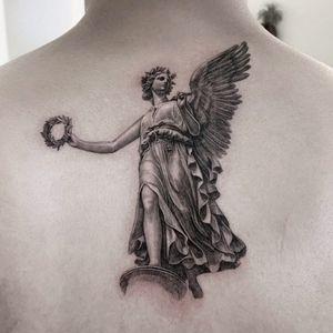 Angel tattoo by Moca Tattoo #MocaTattoo #angeltattoo #angeltattoos #angels #wings #feathers #cherubs #religious #spiritual #back #blackandgrey #realism #realistic