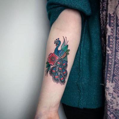 Peacock tattoo by Sanne #Sanne #Motorink #MotoinkFinestTattooing #Amsterdam #Amsterdamtattoo #Amsterdamtattoostudio #tattoostudio #tattooartists #tattooidea #besttattoo #cooltattoo #peacock #arm