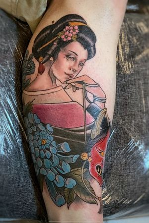 Geisha with mask on leg