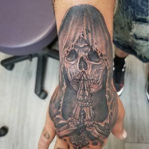 Praying skull on the hand