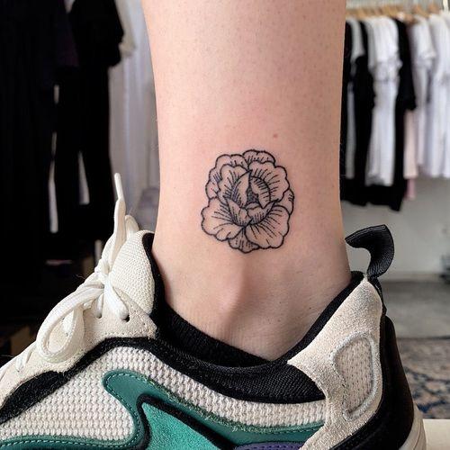 Ankle tattoo by Jix Hanpoke Tattoo #Jixhandpoketattoo #ankletattoo #ankle #leg #smalltattoo #anklet #handpoke #flower #peony #floral #blackwork #linework #dotwork
