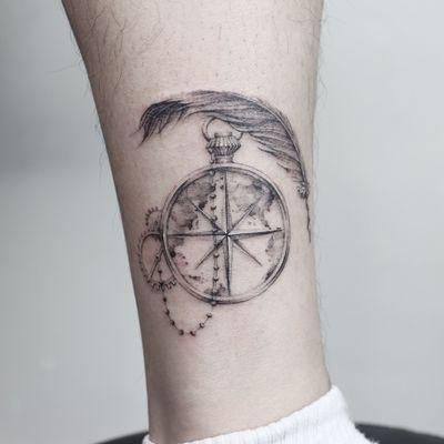 compass with singleneedle #clock #clocktattoo #feather #feathertattoo #blackwork #singleneedle #fineline #newyorktattoo #newyork