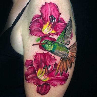Female Tattooers - Flower and Hummingbird tattoo by Megan Massacre #MeganMassacre #FemaleTattooers #ladytattooers #ladytattooartist #femaletattooartist #realism #realistic #flower #hummingbird #bird #arm