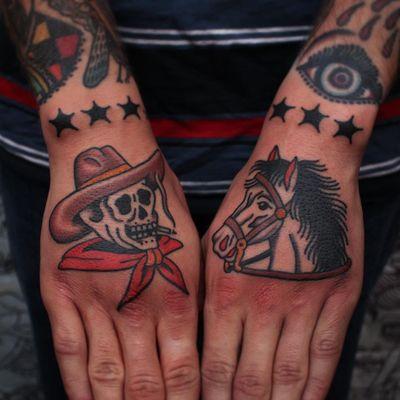 Hand tattoo by Joel Soos #JoelSoos #TattoodoApp #TattoodoApptattooartist #tattooartist #tattooart #tattooidea #inspiringtattoo #besttattoo #awesometattoo #traditional #skeleton #horse #skull #cowboy #hand
