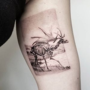 Skeleton tattoo by Goldy Z #GoldyZ #skeletontattoos #skeletontattoo #skeleton #bones #skull #death #anatomy #anatomical #moose #irishelk #realism #realistic #blackandgrey #landscape #arm