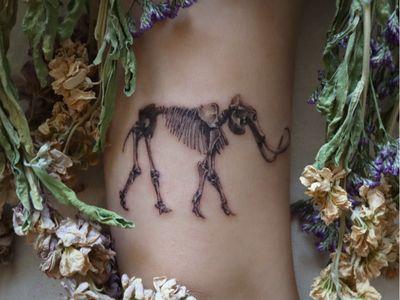 Skeleton tattoo by Tattooist Kimria #TattooistKimria #skeletontattoos #skeletontattoo #skeleton #bones #skull #death #anatomy #anatomical #dinosaur #woollymammoth #blackandgrey #realism #realistic #arm