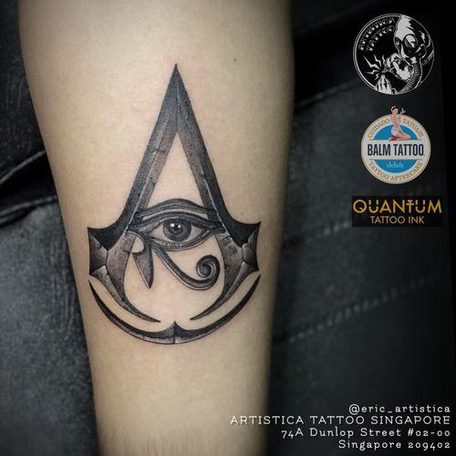 Assassin creed logo with eye of horus using my clients mum eye photo as requested. 🤘🏻 #tattoo #tattooed #tattoosocial #ilovetattoos #tattoolover #sgtattoo #singaporetattoo #customized #blackandgreytattoo #assassincreed #eyeofhorus #forearmtattoo #artistica #artisticasingapore #artisticatattoo #ericartistica #ericlohtattoos #balmtattoo #balmtattoosg #balmtattooteamsg #balmtattooartist #balmtattoosingapore #dragonbloodbutter #quantumtattooink #quantumtattooink_sea #criticaltattoosupply #nedzrotary