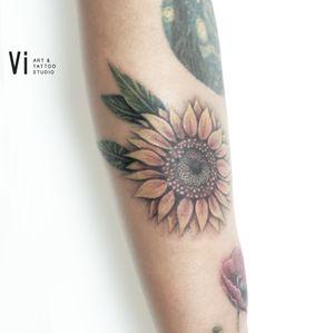 #sunflowertattoo #coloredtattoo #inkedgirls