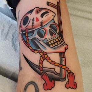 Traditional skull and sythe with hockey mask and rope tie