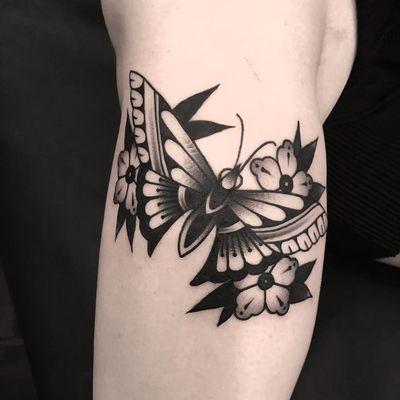 Butterfly tattoo by Derick Montez #DerickMontez #butterflytattoo #butterflytattoos #butterfly #moth #wings #insect #nature #blackwork #traditional #flower #floral #arm