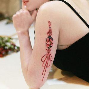 Red lotus norigae #tattoo #norigaetattoo #fantattoo #peonytattoo #colortattoo #flowertattoo #tattooistsion