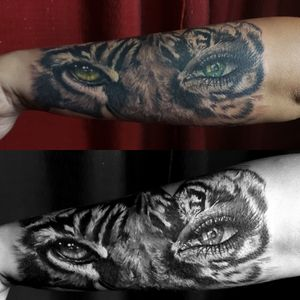 Black and grey with a touch of color forearm tattoo