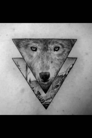 Instagram: @rusty_hst Another black and grey geometric wolf in the books.  #blackandgrey #realism #wolftattoo #blackandgreyrealism #geometric #nature