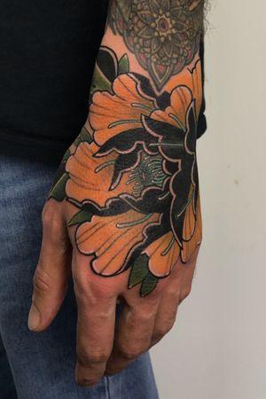 Peony hand tattoo