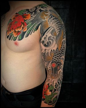 A classic #koi and #peony sleeve by @mattbeckerich