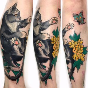 Cover up of an old tribal woth a fun little cat jumping