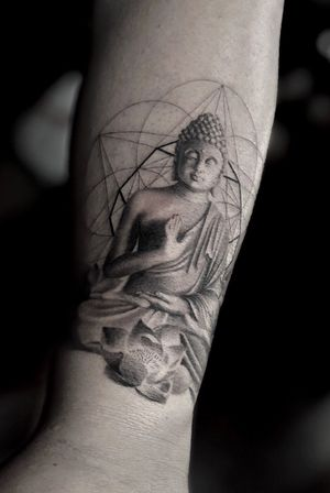 Single needle buddha with a geo backround done at radiant ink lab