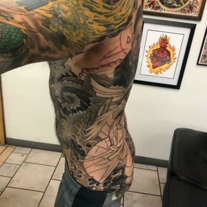 Samurai Shodown back piece - fourth session, picture 3. We are extending it to the upper back, where I already had the Expendables tattoos. We are also tying it all together with my abdomen piece and legs. Artist - Heath Whitten Studio - Hero Tattoo in Conway SC #videogames #retrogaming #snk #arcade #samuraitattoo #samurai #retro #classicgaming #neogeo