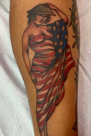 Traditional pinup girl wrapped in a american flag