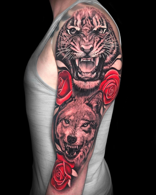 One of my favorite half sleeves done recently at @gritnglory ❤️🐯🌹🐺