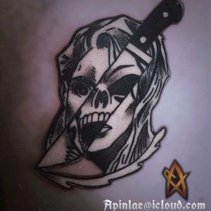 Skull knife tattoo