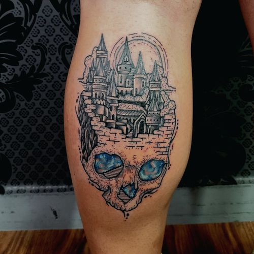 Skull with gothic city and galaxy