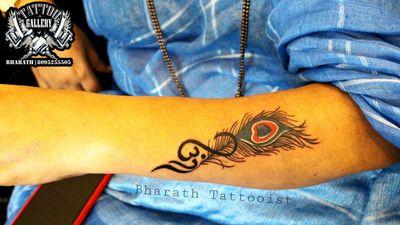 """Peacock Feather"" ""TATTOO GALLERY"" Bharath Tattooist #8095255505 ""Get Inked or Die Naked' #peacockfeathertattoo #colourtattoos #flutetattoo #girlhand #tattooedboy #peacock #hindureligion #tattooedgirls #tattoocalture #tattoo #tattoo #tattooartist #tattoopassion #tattoolife #tattoolifestyle #omtattoo #omwithpeacockfeather #karnatakatattooartist #indiantattoo #davangere #davangeresmartcity #karnataka #indiantattoo #india"