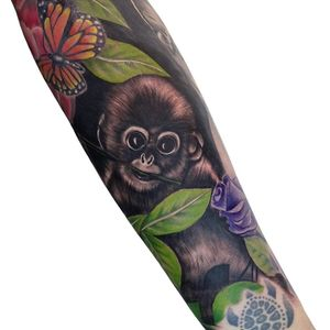 Cheeky monkey with colourful leaves and insects for a full nature sleeve (turtle not done by me)  #monkey #monkeytattoo #nature #animals #animaltattoo #realistic #hyperealism #blackandgreytattoo #colourtattoo #purplerosetattoo