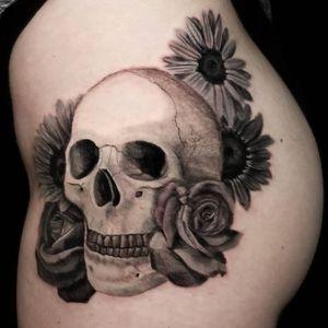 Skull and floral on hip. #skull #skulltattoo #floral #floraltattoo #realism #realistictattoo #blackandgrey #blackandgreytattoo #girlswithtattoos #knoxville #knoxvilletattoo