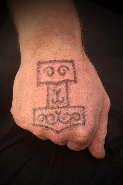 Hand poke Mjølner............................... #thor #thortattoo #handpoke #handpoketattoo #tattoos #dotwork #stikandpoke #dotworktattoo #viking #vikings #reykjavik #iceland #poke #vikingtattoo #vikingtat #dot