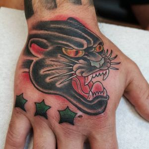Panther on the hand with some stars added to cover some old knuckle tattoos.