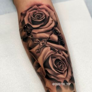 Roses and a rosary on the inner forearm