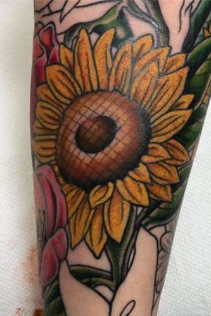 Part of a flower sleeve. Sunflower and part of roses