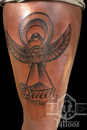 Sacred ankh with winged scarab.