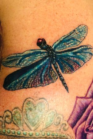 Realistic dragonfly done by Jayvo Scott