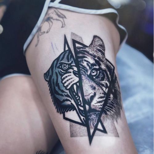 Tiger crossover. Good fun!! Tattooed using @worldfamousink #worldfamousink @fkirons #fkirons #spektraxion @tatsoul #tatsoul #envycartridges @criticaltattoosupply #BeCritical @_numb_skulled #_numb_skulled @blackworksupply @tattoodo Ambassador #tattoodo @bloodlinesinknorthperth #bloodlinesinknorthperth #stencilanchored #hivecaps #inkeeze #chrisrigonitattooer #chrisrigoni #chrisrigoniportfolio #tattoo #tattooartistmagazine #tattooculturemagazine #skinartmag #inkjunkeyz #tattoosnob #inkedmag #thebesttattooartists #tattooselection #Sullenclothing #tattoolifemagazine