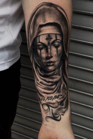 Virgin Mary tattoo